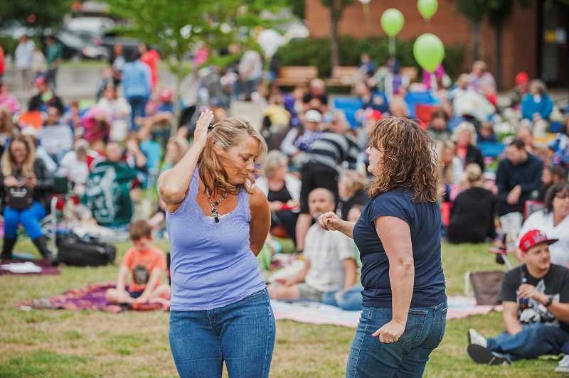 by: JOSH KULLA - Of course, dancing was required for Global FM at Town Center Park.