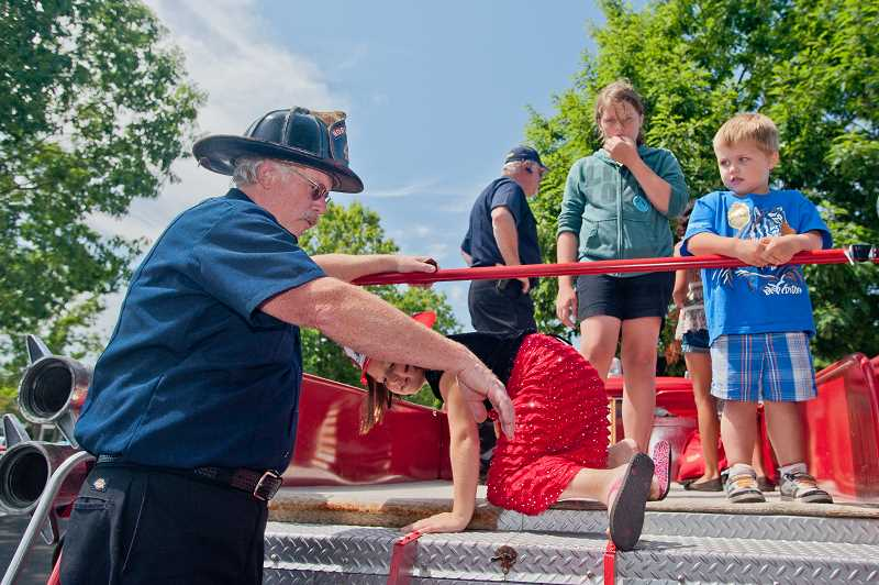 by: JOSH KULLA - Tualatin Valley Fire & Rescue was on hand Saturday with a 1959 Western States fire engine that still 'drives like a beast,' according to firefighters at Fun in the Park.