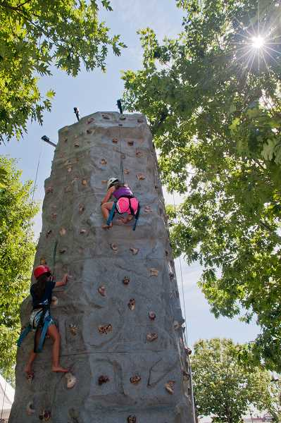 by: JOSH KULLA - A climbing wall sponsored by Valley Christian Church was among the most popular attractions of the day at Fun in the Park.
