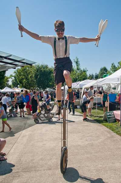 by: JOSH KULLA - Juggler and comedian Curt Carlyle not only performed on the main stage, he also roamed the park on his unicycle as a roving reveler.
