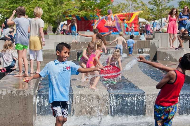 by: JOSH KULLA - With temperatures in the high 70s, Town Center Park's water feature was still a big hit during Fun in the Park.