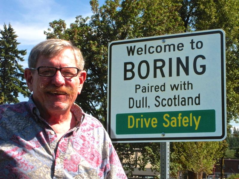 by: POST PHOTO: JIM HART - Steve Bates, chairman of the Boring Community Planning Organization, stands near the sign at Boring Station Trailhead Park, where the Boring and Dull Day celebration is planned for Friday evening.