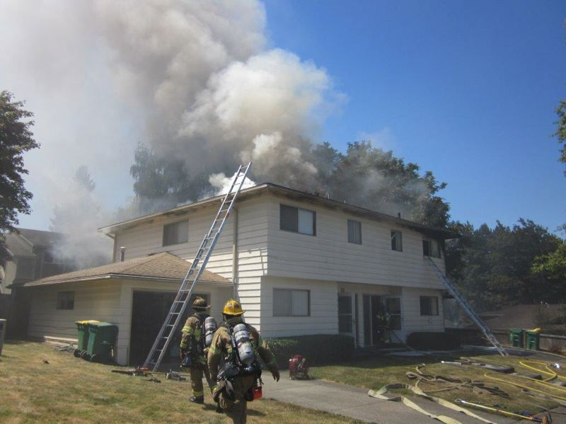 by: TUALATIN VALLEY FIRE & RESCUE - An early afternoon fire on Tuesday damaged this two-story duplex at 7795 SW Hillcrest Court. The seven occupants of the structure were displaced and are staying with family members.
