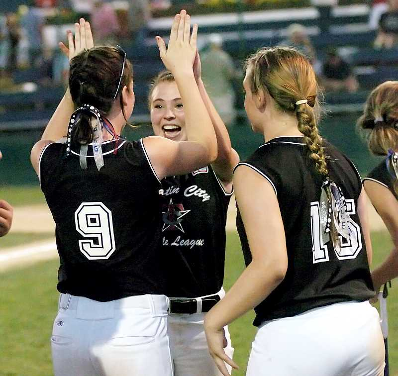by: DAN BROOD - Jubilation - Newberg's Maddie DeVerna (center), Kendra Gooding (No. 9) and Noelle Sawyer (No. 15) celebrate after winning the Oregon District 4 tournament and earning a bid to the Little League Softball World Series, which gets underway Thursday at Alpenrose Stadium in Portland.