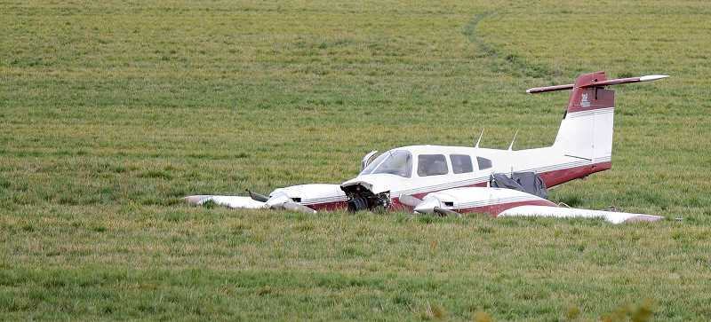 by: FILE PHOTO - Collision's aftermath -- Flight instructor Travis Thompson performed an emergency landing in this 1978 Piper Seminole in a grass seed field east of Champoeg State Heritage Area in October 2011 after the plane collided with another aircraft. Steve Watson of Beaverton died when his 1966 Beech Bonanza V35 collided with Thompson's aircraft and then plunged to the ground near Wilsonville Road and the Willamette River.