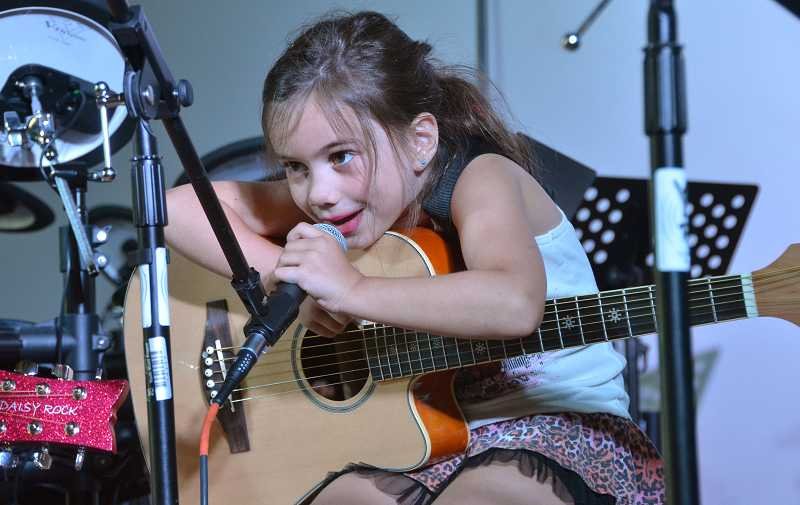 by: PAMPLIN MEDIA GROUP: VERN UYETAKE - Madison Talarico of Wilsonville took part in YMP's 80s camp and performed during the camps last day on July 26.