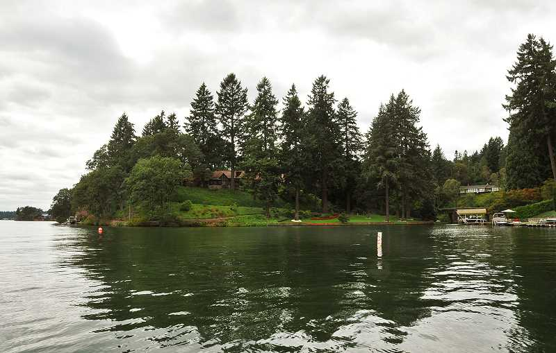 by: VERN UYETAKE - At 1850 North Shore Road, the Jantzen estate, on an island in Oswego Lake, is accessible only by boat or private bridge.