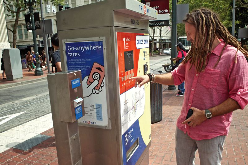 by: TRIBUNE PHOTO: JAIME VALDEZ - TriMet hopes that giving riders more opens for buying fares will reduce the use of its problem-prone vending machines, like this one in downtown Portland.