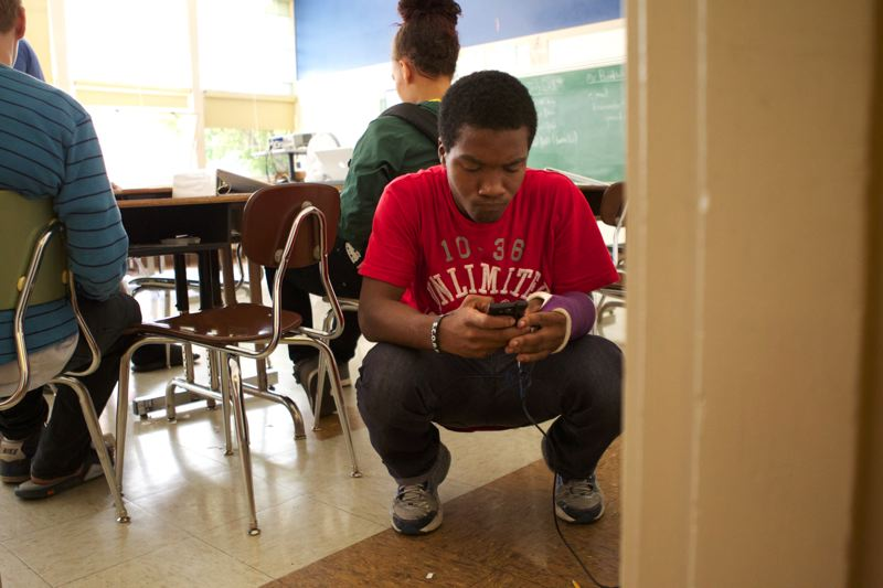 by: TRIBUNE PHOTO: JAIME VALDEZ - Icezick Batiste, 14, an incoming freshman at Wilson High School, takes a text break during a Ninth Grade Counts summer program at Robert Gray Middle School.