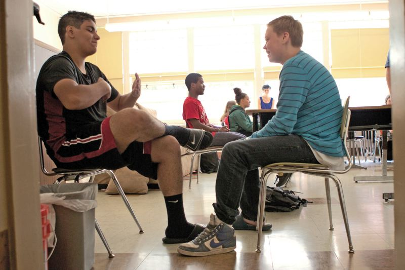 by: TRIBUNE PHOTO: JAIME VALDEZ - Mustafa AlShemary and Max Turner face each other during sharing exercise in Ben Hunter's class. He teaches students how to learn, like quietly listening to others and calmly expressing ones own thoughts.