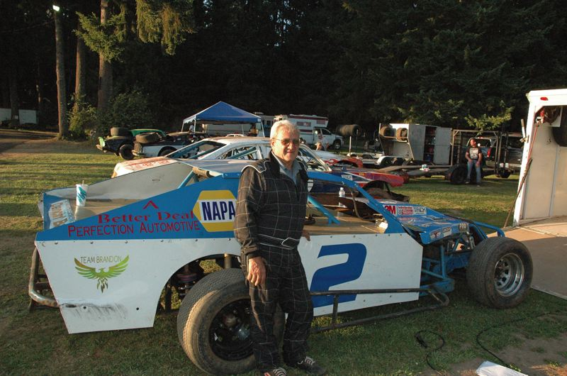 by: COURTESY OF MIKE WEBER - Curtis Zelmer, who lives and works in North Portland, gets ready for another stock-car race at River City Speedway in St. Helens.