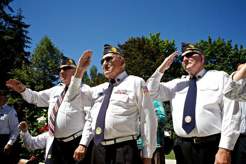by: TIMES PHOTO: JAIME VALDEZ - Members of the American Legion Post No. 124 salute Abraham Trejo, a former U.S. Ranger Marine soldier, after he was initiated into the Air Force at a Tuesday afternoon ceremony at Veterans Memorial Park.