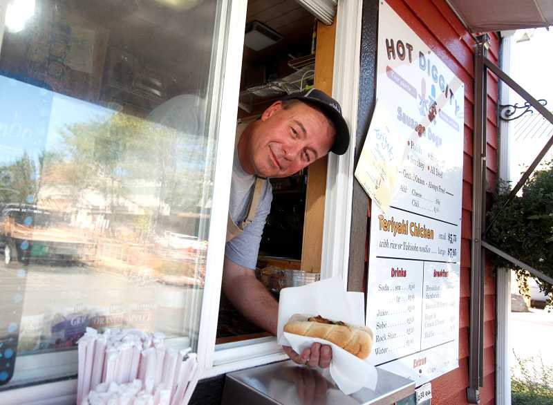TIMES PHOTO: JONATHAN HOUSE - Scott Tepedino has been selling sausages and teriyaki from his food cart Hot Diggity Dog in the parking lot of The Home Depot for years. Tepedino is one of a few food carts that have made a name for themselves in Tigard long before Portlands food cart obsession started to spread.