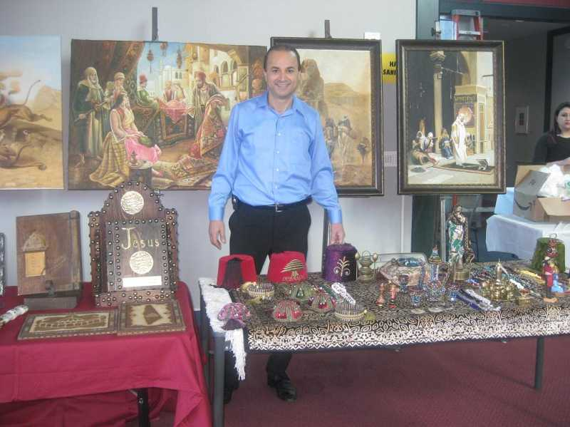 by: SUBMITTED PHOTO - Beaverton resident Hadi Nouredine, president of Arab American Cultural Center of Oregon, shares a collection artifacts on display at last year's festival.