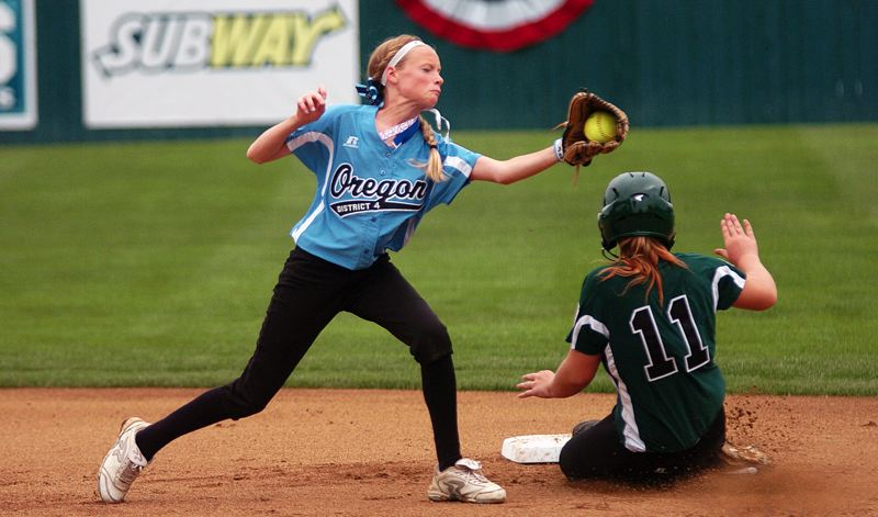 by: DAN BROOD - NICE CATCH -- Tualatin City shortstop Camille Hall (left) grabs the ball as Central's Gabrielle Shackelford slides to second on a stolen base attempt in Thursday's Little League World Series game.