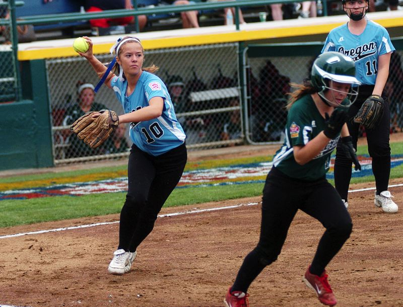 by: DAN BROOD - NO YOU DON'T -- Tualatin City first baseman Lindsay Stadick (left) is about to throw out Central's Maegan Phares after fielding a bunt in Thursday's Little League World Series game.
