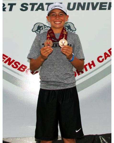 by: SUBMITTED PHOTO - Hunter Gilbert of the Tigard Youth Track Club placed sixth in both the pentathlon and the 800-meter run at the USATF National Championships held in North Carolina.