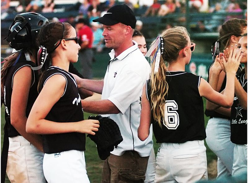 by: DAN BROOD - WINNERS -- Joey Hall and the Tualatin City Little League softball team keep their spirits high during play in the District 4 tournament championship game.
