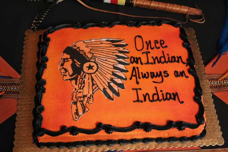 by: CLASS OF 68 - Cake at the class reunion with reunion theme and Indian logo