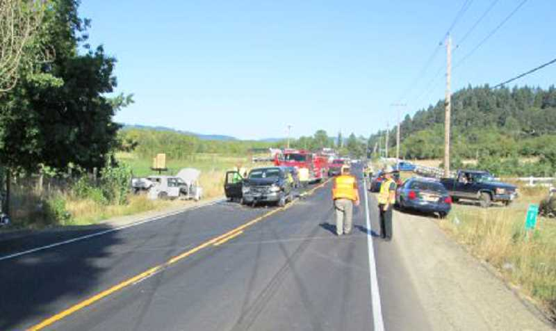 by: PHOTO COURTESY OF OREGON STATE POLICE - A two-vehicle crash on Highway 240 about 5 miles west of Newberg temporarily blocked traffic on Tuesday. Four people were injured in the accident, while a fifth passenger was unharmed.