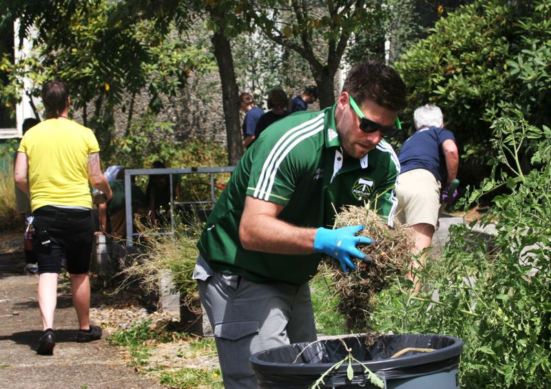 by: OUTLOOK PHOTO: JIM CLARK - Portland Timbers defender David Horst and Timber Joey, a.k.a. Joey Webber, joined volunteers from Alaska Airlines, school officials and students for a garden volunteer party at H.B. Lee Middle School on Wednesday, Aug. 7.