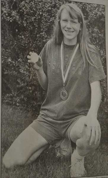 by: FILE PHOTO - Melanie Bemis poses with her hardware after winning the girls long jump competition at the OSAA state track and field championships in 1993.