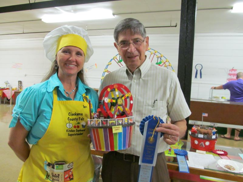 by: PHOTO BY ELLEN SPITALERI - Susan Sommers, the Kitchen Cupboard superintendent, awarded a blue ribbon to Eugene Fankhauser, who won the Contain Your Cookie competition, last year at the county fair.