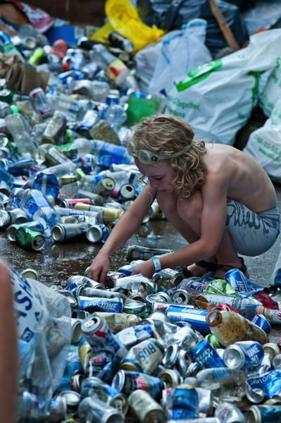 by: PHOTO BY: MARK GAMBA - A boy sorts through beer cans at last year's Clackamas River clean-up activity.