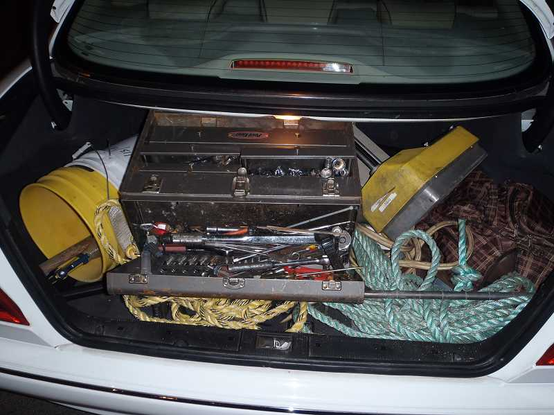 by: SHERWOOD POLICE DEPARTMENT - Police found numerous tools in the trunk of this car on Aug. 2. Two men were arrested.