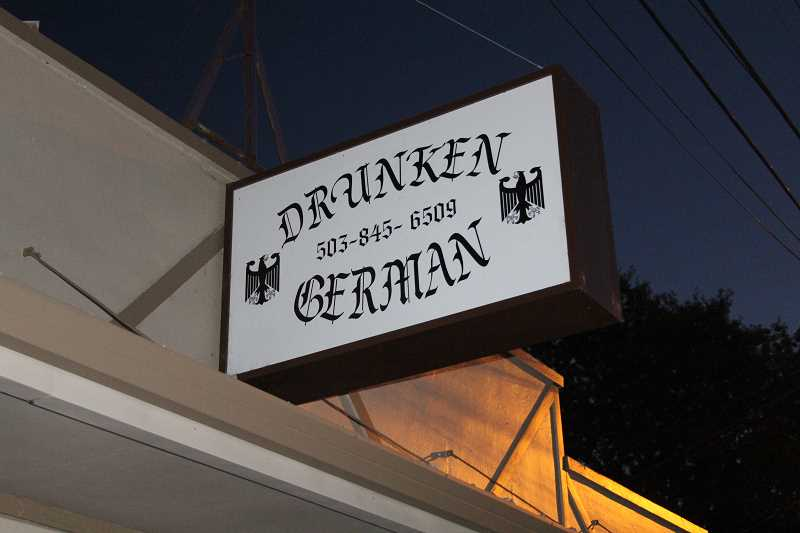 by: JEFF MCDONALD  - The city of Mount Angel sent a letter to the owner of the Drunken German saying this sign was out of compliance. The projecting sign does not meet the citys new code ordinance.