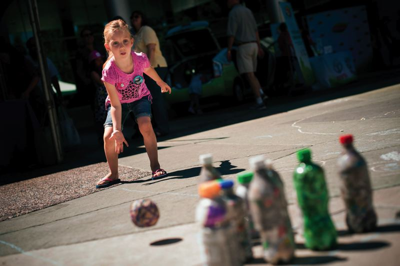 by: PAMPLIN MEDIA GROUP: NICK FOCHTMAN - Kids play Trashy Bowling at a Trash For Peace booth.
