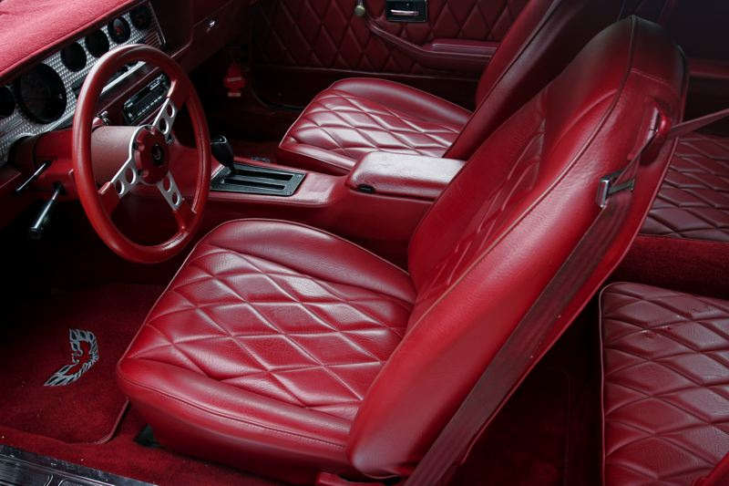 by: OUTLOOK PHOTO: JIM CLARK - When Lewis decided to refurbish his 1980 Trans Am, he had the interior reupholstered in red diamond-tuck.
