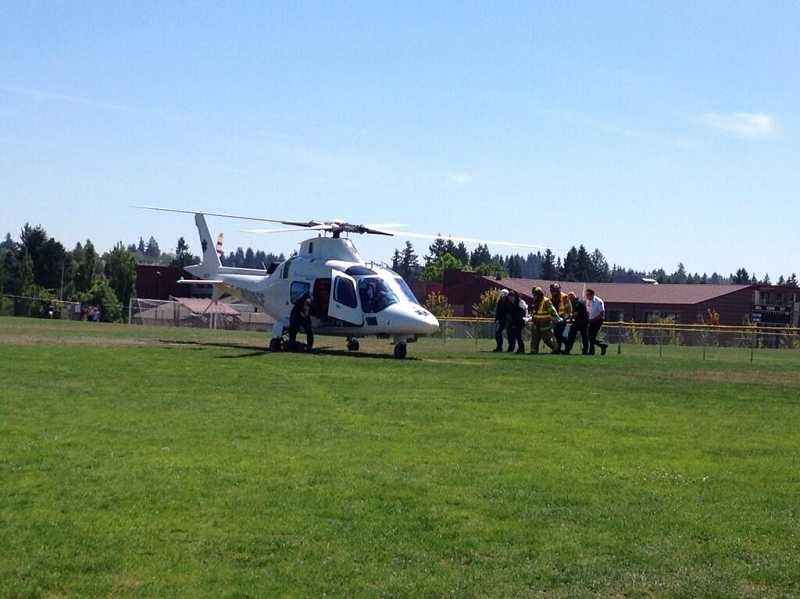 by: TVF&R - A Life Flight helicopter lands in a Sherwood field Tuesday afternoon, transporting a 3-year-old boy to Legacy Emanuel Medical Center.