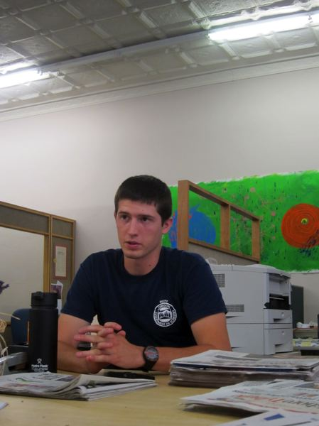 by: NEWS-TIMES PHOTO: KATHLEEN ROHDE - Cody Brown of Forest Grove, 21, talks about his experience fighting wildland fires in Douglas County Monday at the News-Times office.
