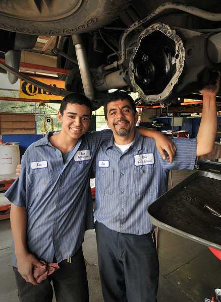 by: TIDINGS PHOTO: VERN UYETAKE - Isa Flores' son, Isa Flores Jr., works part time alongside his father at Isa's Auto Service - which will soon move to Oregon City.