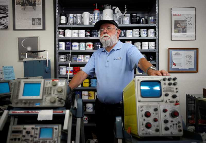 by: TIMES PHOTO: JONATHAN HOUSE - Former Tektronix employee and head of VintageTEK, a museum of old eqiupment, Stan Griffiths talks about the history behind a few of the company's oscilloscopes.