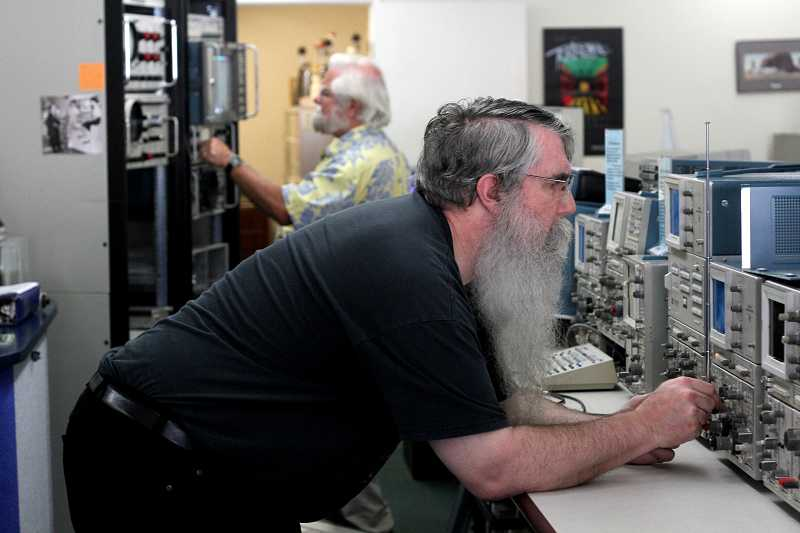 by: TIMES PHOTO: JONATHAN HOUSE - VintageTEK volunteers Dave Brown, foreground, and Philip Crosby, both former Tektronix employees, fine tune equipment in the mini-museum and shop that they run in Beaverton.