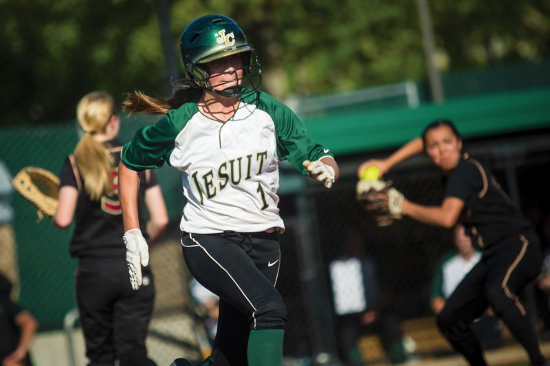 by: TIMES PHOTO: JAIME VALDEZ - Crusaders catcher Emily Preble was first-team all-Metro for the Jesuit softball team this season. Shell be back next year as a sophomore.