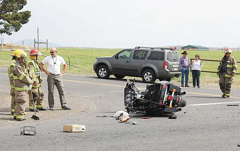 by: SUSAN MATHENY - Debris is strewn across U.S. Highway 97 on Aug. 8, at the scene of a crash that critically injured Madras resident Don Heckathorn, chief of Jefferson County Emergency Medical Services.