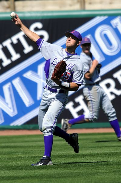 Former Lakeridge standout Nick Fisher was one of the key hitters for a Linfield team that recently won a national title.