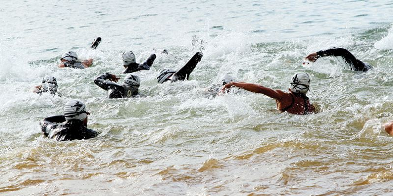 by: COURTESY PHOTO: LEONARD JOHNSON/HOTFOOTPHOTO - Swimmers enter the water during the triathlon at Saturday's Xterra PDX Epic Off Road Weekend, held at Henry Hagg Lake in Gaston.
