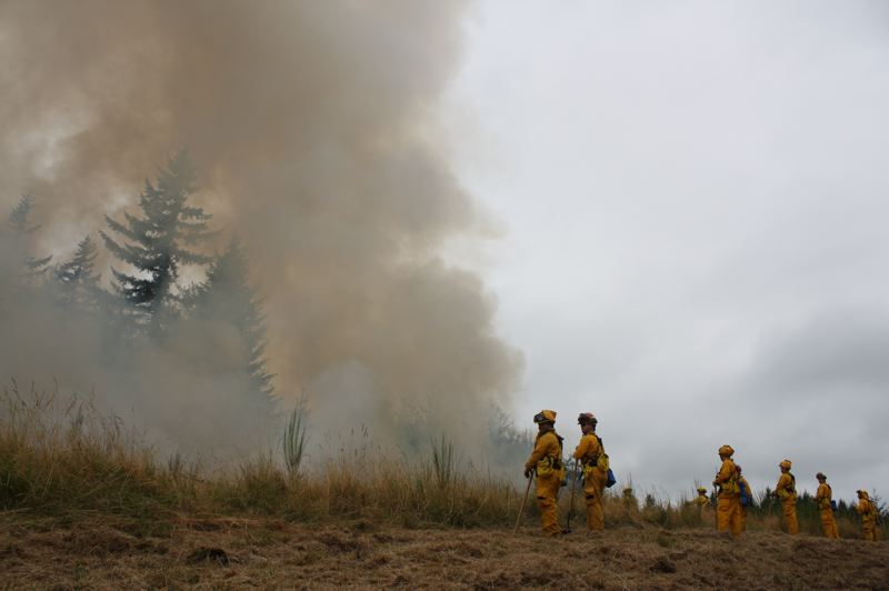 by: SPOTLIGHT PHOTO:ROBIN JOHNSON - Fire Crews survey the line of a prescribed burn off JP West Road on Saturday during a training exercise.