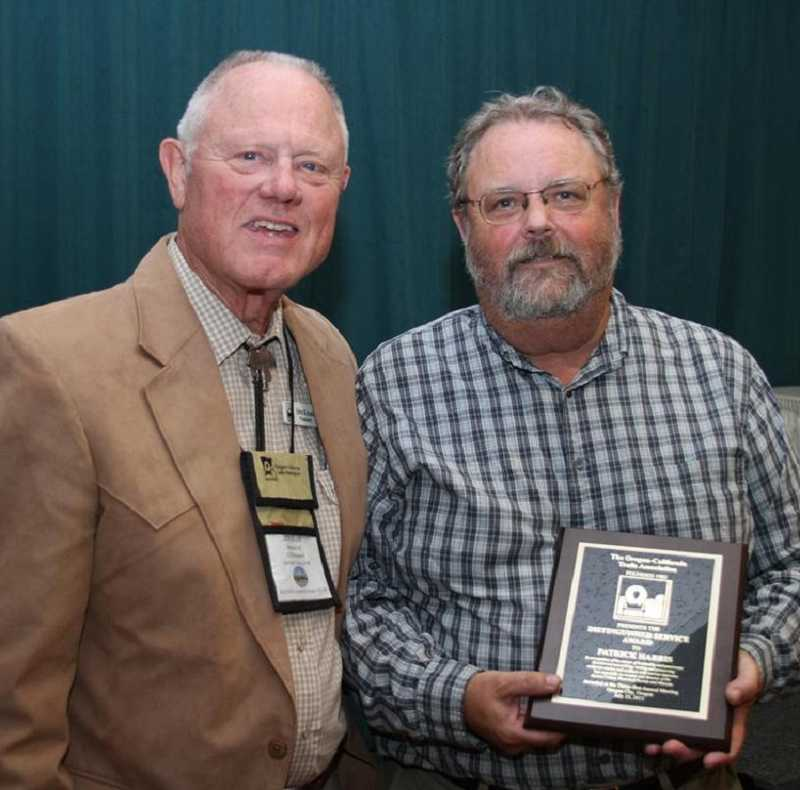 by: SUBMITTED PHOTO - Patrick Harris, right, receives his award July 23.