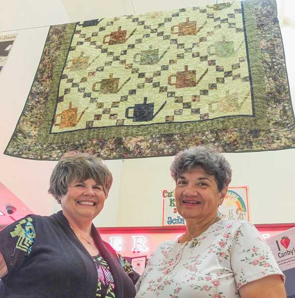 by: RAY HUGHEY - Supporters of the St. Patrick Food Bank Community Garden hope to grow some funds as well as crops. They're raffling off a full-size bed quilt made by Donna DeKoning to benefit the garden project in its second year.