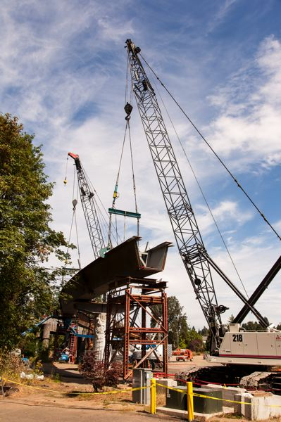 (Image is Clickable Link) by: COURTESY OF TRIMET - Construction crews worked for 44 hours straight to lift six large steel girders into place last week for the Kellogg Bridge into downtown Milwaukie.