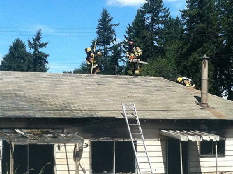 by: TUALATIN VALLEY FIRE & RESCUE - Crews from Tualatin Valley Fire &  Rescue control a major house fire on Tonquin Road Sunday.