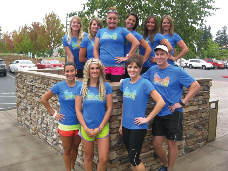 by: SANDY POST: DAVID BALL - Members of Team Hooters gather outside the Mt. Hood Athletic Club, which is sponsoring this years relay team.