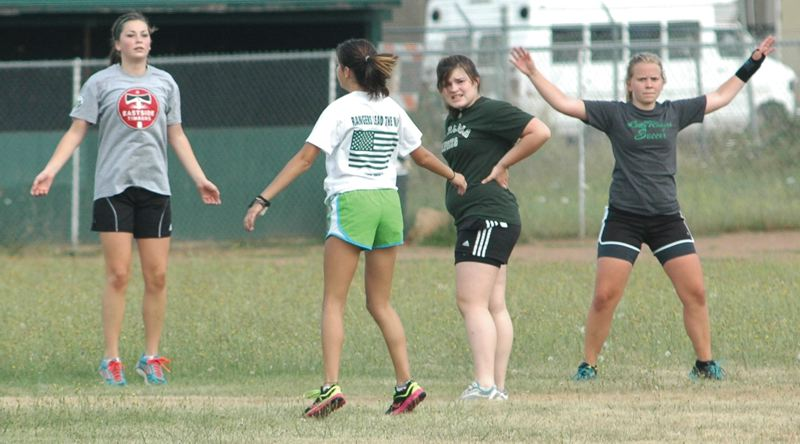 by: ESTACADA NEWS: PARKER LEE - Members of the Estacada girls soccer team go through warm-up drills before Mondays practice under new head coach Heidi Hunt.