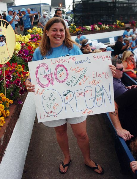 by: DAN BROOD - SIGN OF THE TIMES -- Holly Sawyer shows off her sign, supporting the Tualatin City team.