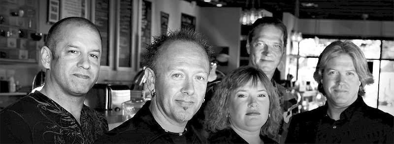 Butch Kent and Shawna Gentert (middle) formed the band 18:20 some years ago and continue to pursue their 